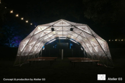 A scissor structure with light design by A03 for a stage by night.