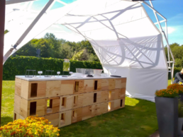 Wooden Bar under sheltered tent with white membrane for event
