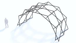 Scissor structure next to person for scale