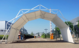arched design structure covered used as an entrance for an event