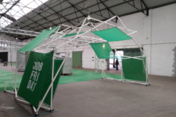 White design structure Fastival with green panels and logos for brand activation