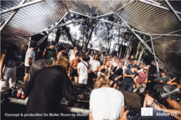 Crowd in front of DJ with covered structure