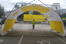 Covered Tent structure with yellow and white membrane for brand activation at event