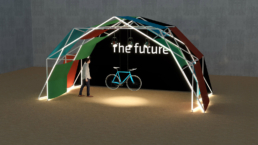 Person and bike under sustainable exhibition booth