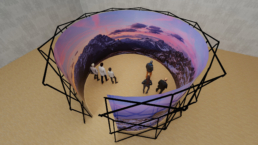 People in front of 360 degree screen exhibition structure
