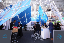 People under beautiful exhibition stand with blue panels