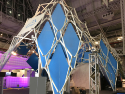 Scissor Structure with blue panels as fair booth